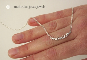 Silver chain with a NAME.