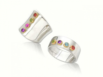 sterling silver ring with four gemstones set in gold 18k.