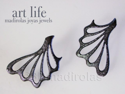 Sterling silver earrings (texture and patina).