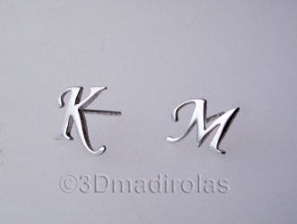 Silver earrings with a Capital letter.