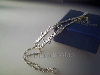 Silver wrist chain with two NAMES.