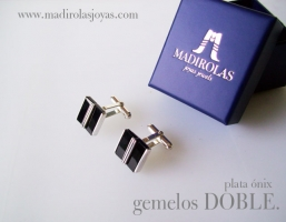 Silver cufflinks with a double gemstone.