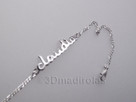 Silver wrist chain with a NAME.